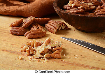 Chopped pecans - close up of chopped pecans on a cutting...