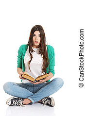 Teenager reading book