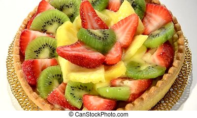 A dessert. Fruit tart on white plat - Fruit tart rotating....