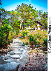 Natural stone stairs leading to house on cliff - Natural...