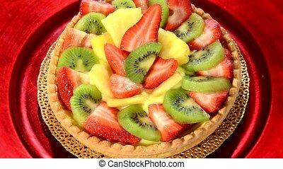 A dessert Fruit tart on white plat - Fruit tart rotating...