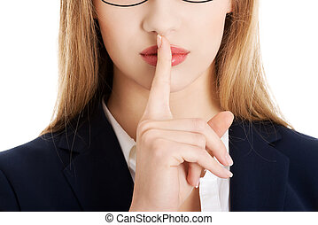 Woman making silent gesture - Young businesswoman making...
