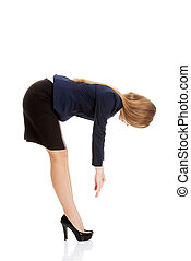 Business woman bend down - Young business woman bend down