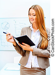 banking report - Business woman standing at the office with...