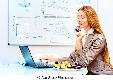 free time - Beautiful businesswoman working in the office...