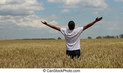 farmer thanks to God for the harvest in wheat field