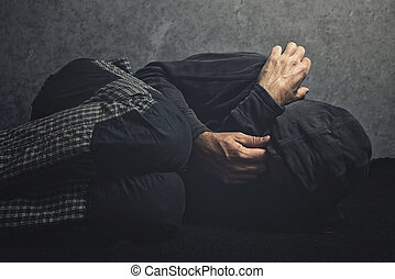 Drug Addict laying on the floor in agony, having an...