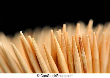 Wooden Toothpicks Close-Up on Black Background