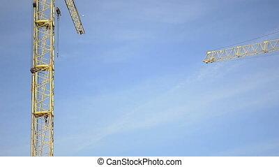Worker climbing up a crane