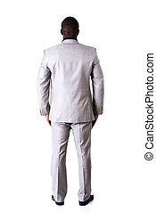 African businessman standing back - Attractive african...