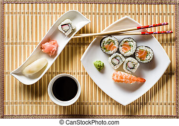 Sushi on white plate top view
