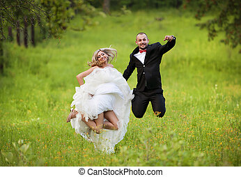 Bride and groom enjoying wedding day in nature