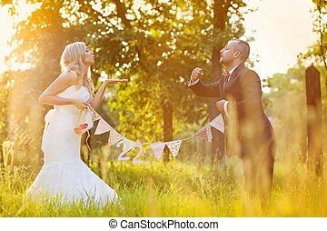 Bride and groom enjoying wedding day in nature - Happy bride...