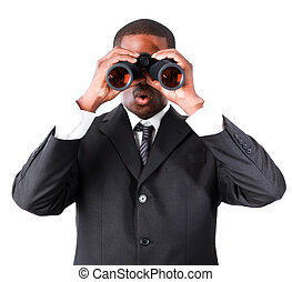 Close-up of an young businessman with binoculars