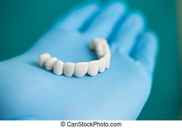 Dental Bridge - Dentist Showing to Patient Dental Tooth...