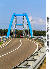Blue Bridge - 02 - A blue steel structure of a bridge...