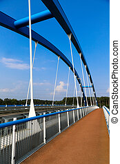 Blue Bridge - 03 - A blue steel structure of a bridge...