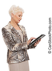 Senior woman using a tablet - Happy senior woman using a...