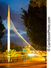 Pedestrian bridge over Segura river in night. Murcia -...