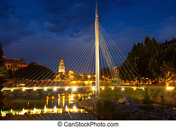 pedestrian bridge over Segura in night Murcia, Spain -...