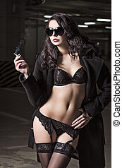 Portrait of pretty smoking young girl in underwear and coat...