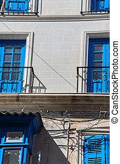 Facade of building with balconys somewhere in Malta - Facade...