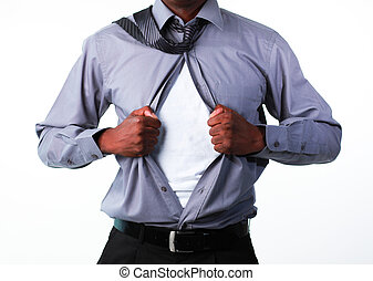 Portrait of a businessman showing tshirt under his suit -...