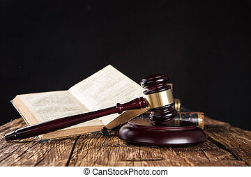 Wooden gavel and books on wooden table, law concept