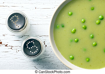 pea soup and salt shaker - top view of pea soup and salt...