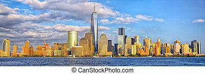 Lower Manhattan skyline panorama before sunset, New York