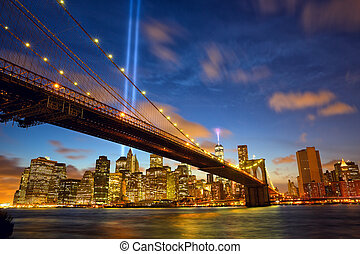 Lower Manhattan skyline with Brooklyn Bridge and the Towers...