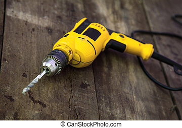 Drilling machine on wood background