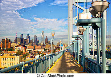 Philadelphia skyline and Ben Franklin Bridge walkway,...