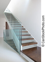 wooden stairs with glass balustrade in modern interior and...