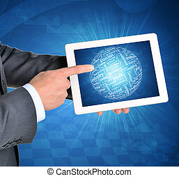 Man hands using tablet pc Sphere of business words on touch...