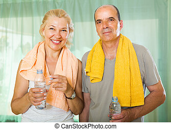 Elderly couple after training - Active elderly spouses with...
