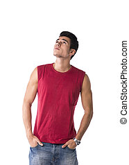 Attractive young man in red tanktop and jeans, looking up -...