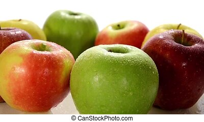 diverse apples close up - apples rotating over white...