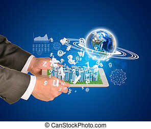 Man hands using tablet pc Business city on touch screen...