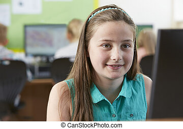 Female Elementary School Pupil In Computer Class