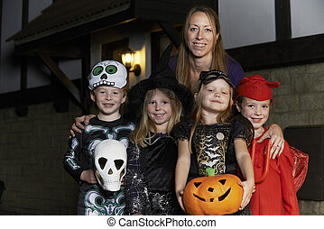 Halloween Party With Children Trick Or Treating In Costume...