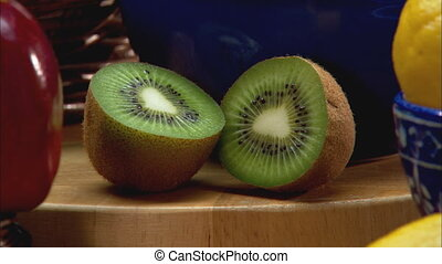 Kiwifruit CU zoom - XCU of sliced open kiwifruit on a...