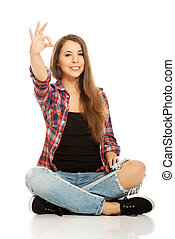 Woman sitting cross-legged - Happy woman sitting cross...