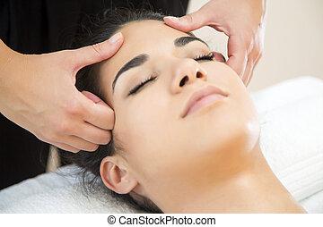 Head massage - Young woman having a head massage