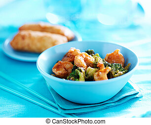 chinese shrimp stir fry in colorful table setting