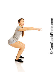 Woman doing squats - Young active woman doing squats