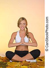 woman practicing yoga in fall