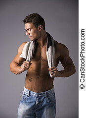Hunky male model drying himself with a towel - Hunky...
