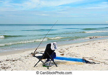 Beach Chair with Fishing Rod - A Beach Chair with Fishing...
