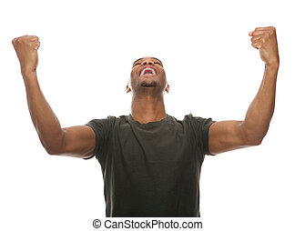 Cheerful young man shouting with arms raised in success